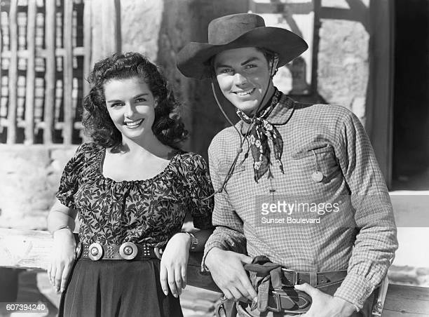 American actors Jane Russell and Jack Buetel on the set of The Outlaw directed by Howard Hughes