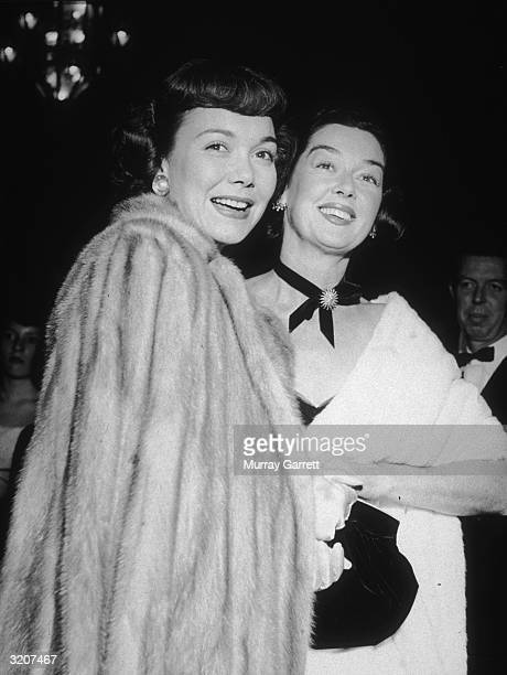 American actors Jane Wyman and Rosalind Russell smile while attending the premiere of director Jean Negulesco's film 'Johnny Belinda' Hollywood...