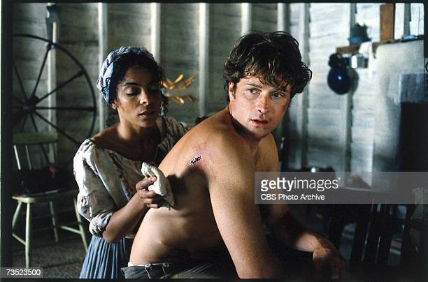 American actors Jasmine Guy and Timothy Daly appear in a scene from the television miniseries 'Queen' directed by John Erman in which Berry plays the...