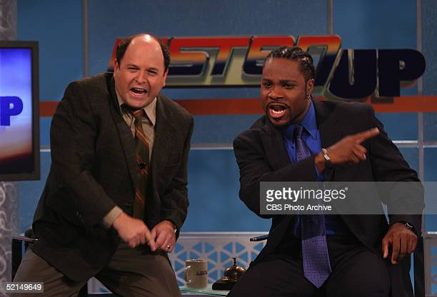 American actors Jason Alexander and MalcolmJamal Warner gesture enthusiastically on the set of the television comedy series 'Listen Up' Los Angeles...