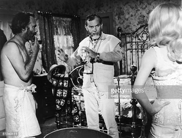 1970 American actors Jason Robards and Stella Stevens with American director Sam Peckinpah on set of Peckinpah's film 'The Ballad of Cable Hogue'