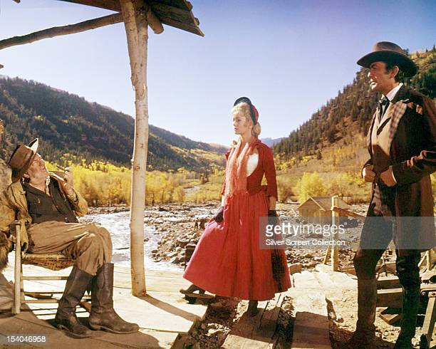 American actors Jay C Flippen as Huggins Debbie Reynolds as Lilith Prescot and Gregory Peck as Cleve Van Vale in 'How The West Was Won' 1962 The film...