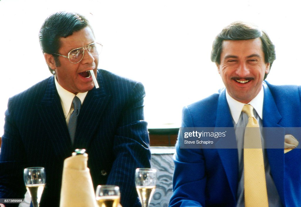 American actors Jerry Lewis (1926 - 2017) (left) and Robert De Niro share a laugh on the set of their film 'The King of Comedy' (directed by Martin Scorcese), 1982.