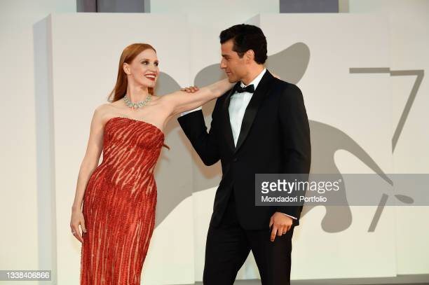 """American actors Jessica Chastain and Oscar Isaac on the red carpet of the movie """"Scenes From a Marriage """" during the 78th Venice International Film..."""