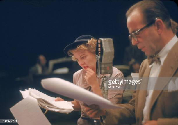 American actors Joan Fontaine and Humphrey Bogart read from scripts during a radio performance of the Theatre Guild of the Air adaptation of Ernest...