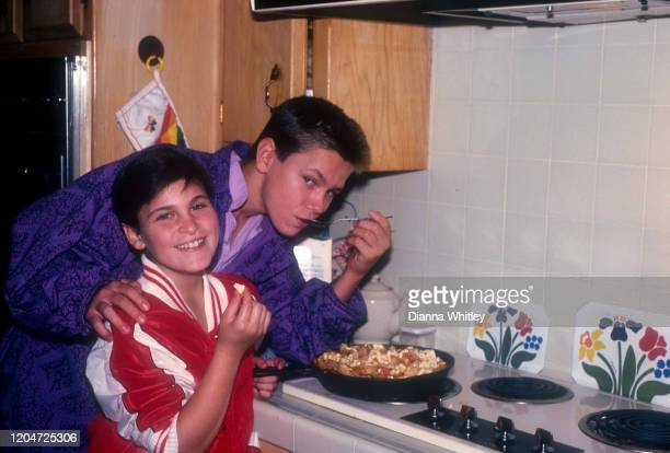 American actors Joaquin and River Phoenix cooking at their home in Los Angeles California US circa 1985