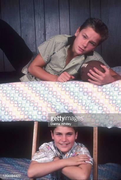 American actors Joaquin and River Phoenix in the bunk bed they shared at their home in Los Angeles California US circa 1985