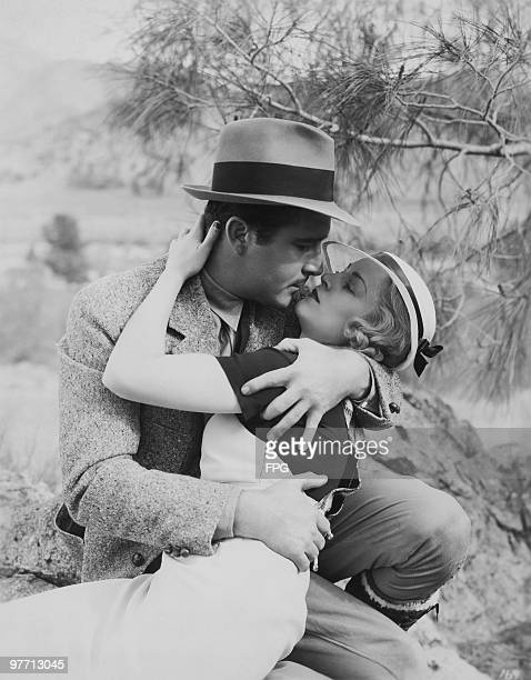 American actors John Boles and Claire Trevor rehearsing a love scene for 'Wild Gold' on location at Kernville California 1934 The film is directed by...