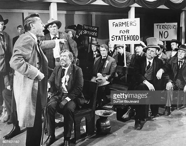 American actors John Carradine Edmond O'Brien and James Stewart on the set of The Man Who Shot Liberty Valance directed and produced by John Ford