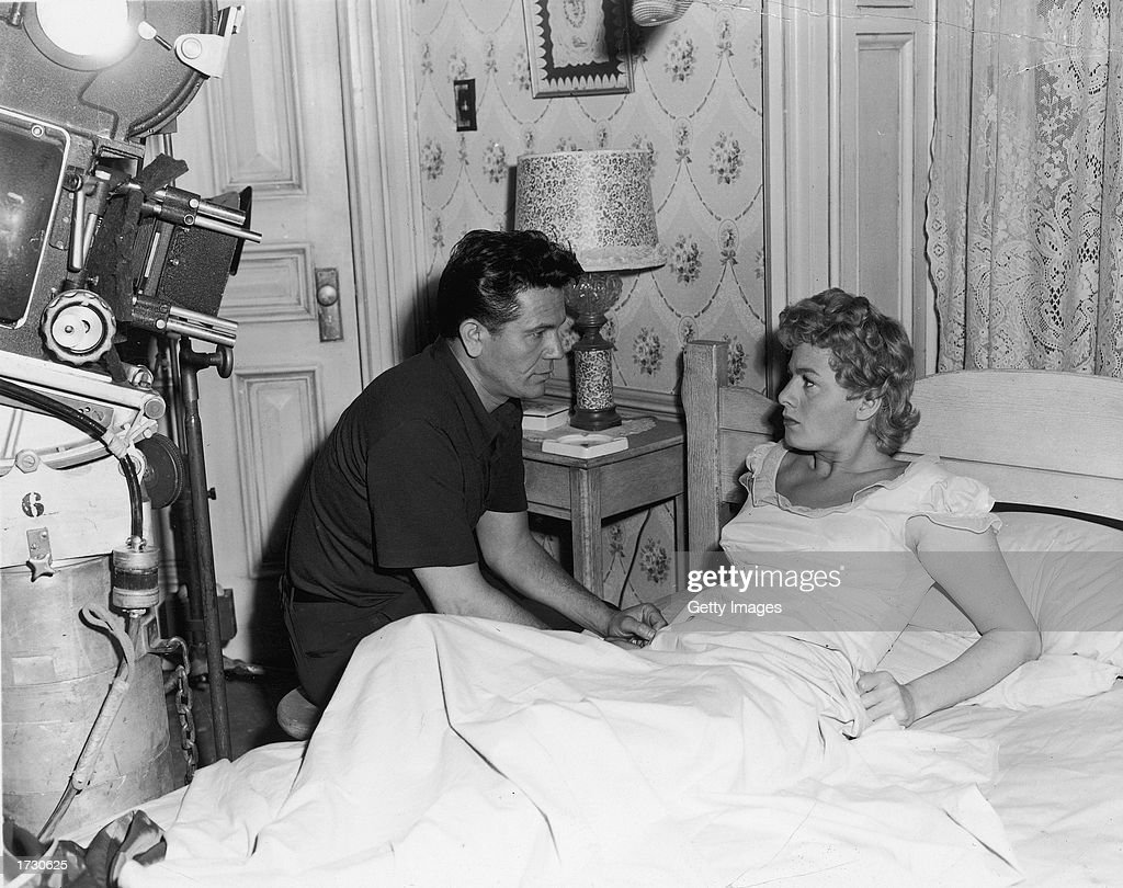 American actors John Garfield (1913 - 1952) and Shelley Winters during the filming of a bedroom scene on the set of the film, 'He Ran All the Way,' directed by John Berry, 1951. This was Garfield's last film before his death from coronary thrombosis.
