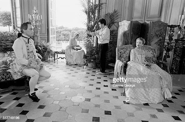 American actors John Malkovich Uma Thurman and Michelle Pfeiffer on the set of the film 'Dangerous Liaisons' based on the Choderlos de Laclos novel...