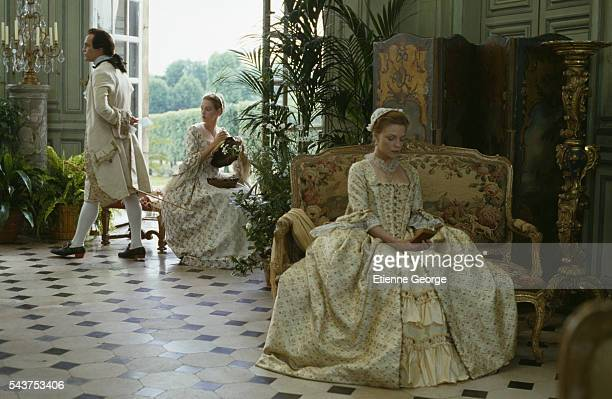 American actors John Malkovich Uma Thurman and Michelle Pfeiffer on the set of the film 'Dangerous Liaisons' directed by English director Stephen...
