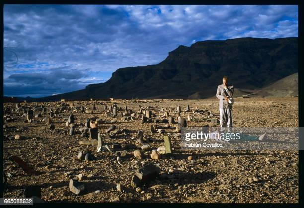 American actors John Malkovitch and Debra Winger in the rocky Morrocan desert during the shooting of the movie Un The au Sahara or Il Te Nel Deserto...