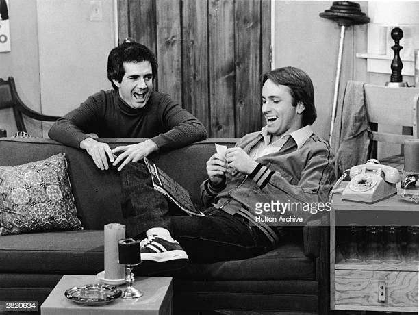 American actors John Ritter and Richard Kline share a laugh in a still from the television series 'Three's Company' circa 1970s