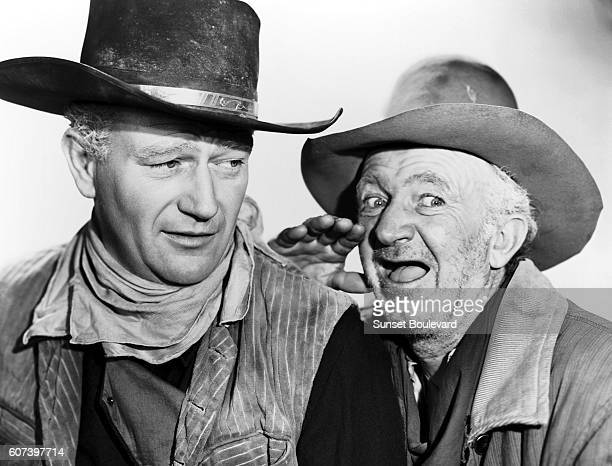 American actors John Wayne and Walter Brennan on the set of Red River directed by Howard Hawks and Arthur Rosson