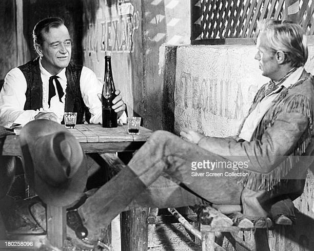 American actors John Wayne as Davy Crockett and Richard Widmark as Jim Bowie in 'The Alamo' directed by Wayne 1960