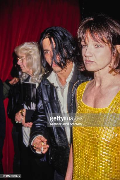 American actors Johnny Depp and Ellen Barkin attend the APLA Fashion Show Honors Isaac Mizrahi at the Mann's Chinese Theater in Los Angeles,...
