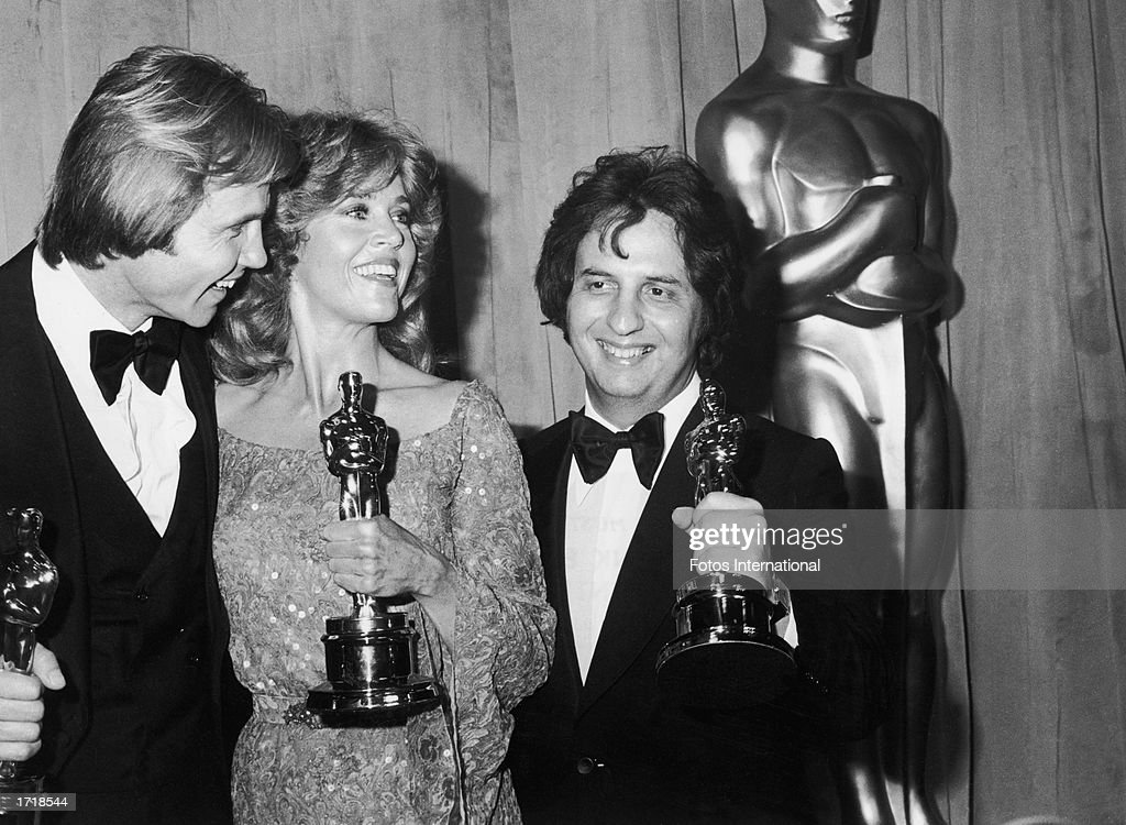 American actors Jon Voight and Jane Fonda pose with American director Michael Cimino, holding their Oscars on stage at the 51st Annual Academy Awards, Los Angeles, California, April 9, 1979. Voight and Fonda received the Best Actor and Actress Oscars for their performances in the film, 'Coming Home.' Cimino received the Best Director Oscar for his film, 'The Deer Hunter.'