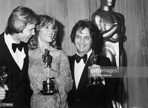 American actors Jon Voight and Jane Fonda pose with American director Michael Cimino holding their Oscars on stage at the 51st Annual Academy Awards...