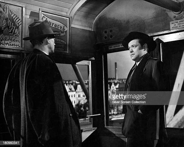 American actors Joseph Cotten as Holly Martins and Orson Welles as Harry Lime in the ferris wheel scene from 'The Third Man' directed by Carol Reed...