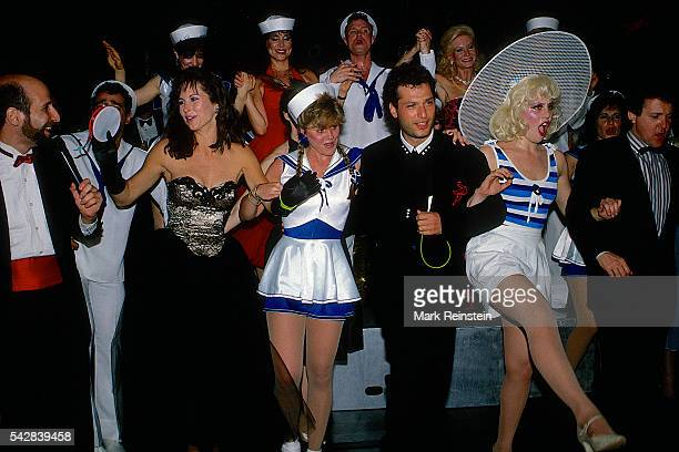 American actors Karen Kopins and Howie Mandel join a dance line with unidentified others during an American Cancer Ball fundraiser Washington DC May...