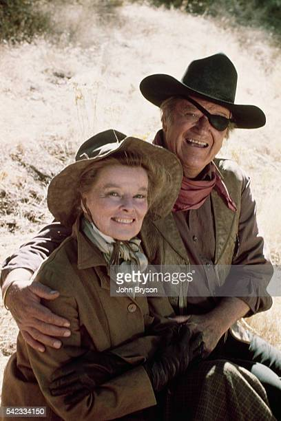American actors Katharine Hepburn and John Wayne on the set of Rooster Cogburn, directed by Stuart Millar.