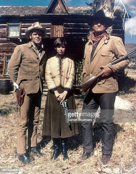 American actors Kim Darby Glen Campbell and John Wayne on the set of True Grit based on the novel by Charles Portis and directed by Henry Hathaway