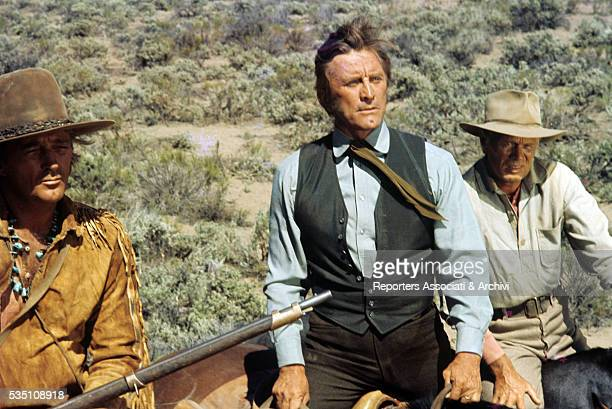 American actors Kirk Douglas and Robert Mitchum preparing a scene on the set of The Way West USA 1966
