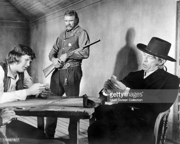 American actors Kris Kristofferson as Billy the Kid Richard Jaeckel as Sheriff Kip McKinney and James Coburn as Sheriff Pat Garrett in 'Pat Garrett...