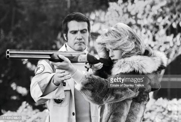 "American actors Lee Majors and Farrah Fawcett on the set of ""The Six Million Dollar Man"" on January 18, 1974."