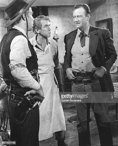 American actors Lee Marvin James Stewart and John Wayne on the set of The Man Who Shot Liberty Valance directed and produced by John Ford