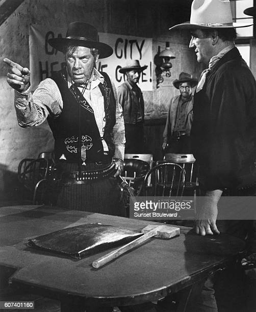 American actors Lee Marvin, Lee Van Cleef and John Wayne on the set of The Man Who Shot Liberty Valance directed and produced by John Ford.