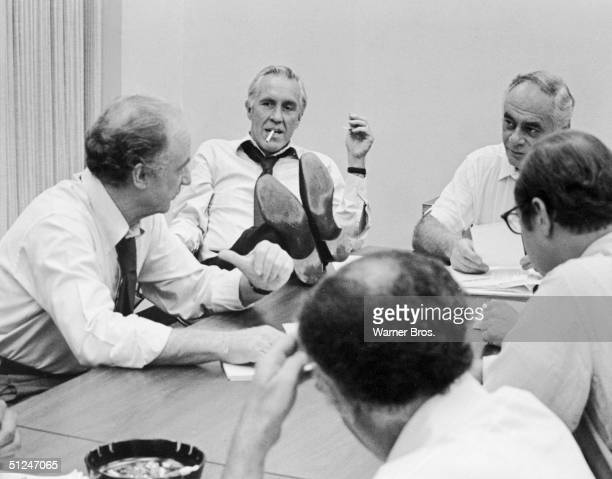 American actors, left to right, Jack Warden, Jason Robards , Martin Balsam and others have a meeting in a still from the film, 'All the President's...