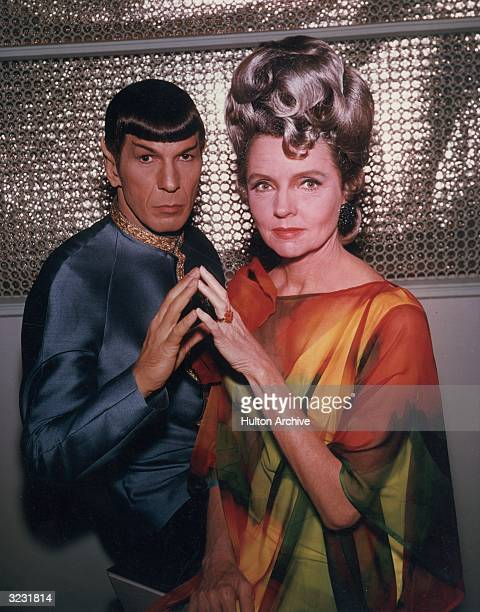 American actors Leonard Nimoy and Jane Wyatt pose in costume in a promotional portrait for the television series, 'Star Trek,' for an episode...