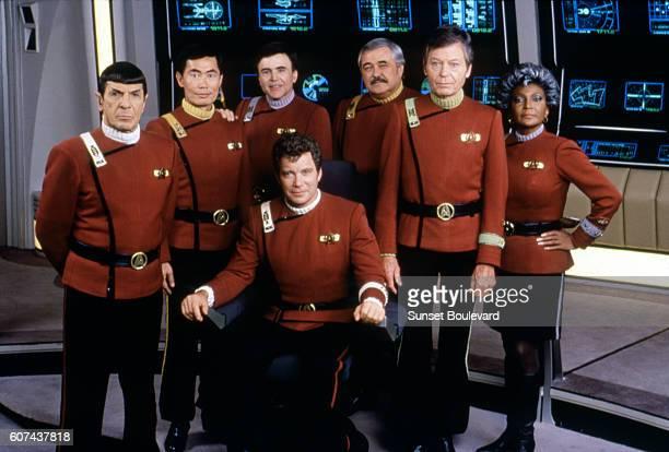 American actors Leonard Nimoy, George Takei, Walter Koenig, DeForest Kelley, Nichelle Nichols, and Canadian William Shatner on the set of Star Trek...