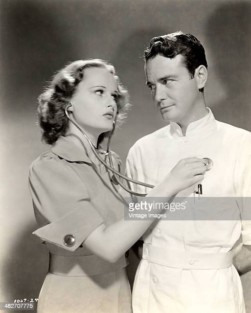 American actors Lew Ayres and Lynne Carver in a publicity still for the film 'Young Dr Kildare' 1938 Photo by Milton Brown