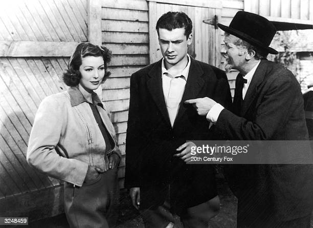 American actors Loretta Young Richard Greene and Walter Brennan in a still from the film 'Kentucky' directed by David Butler