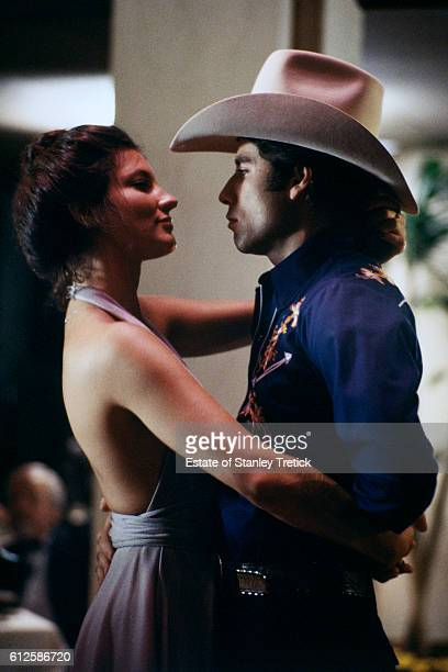 American actors Madolyn Smith and John Travolta on the set of Urban Cowboy written and directed by James Bridges