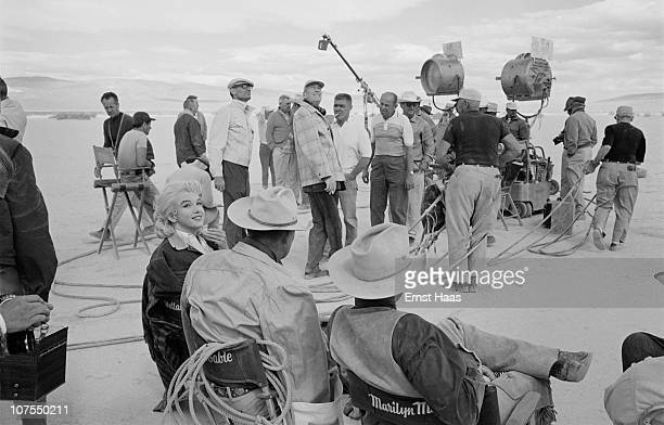American actors Marilyn Monroe and Clark Gable during the location shoot of 'The Misfits' in the Nevada Desert 1960 In the background are costar Eli...