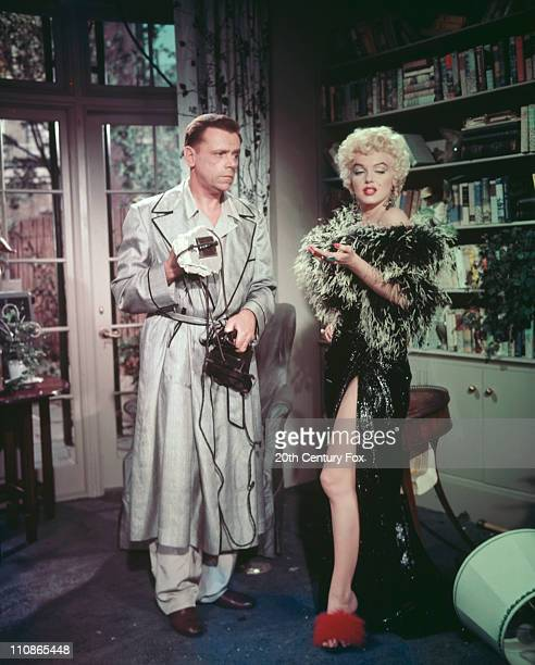American actors Marilyn Monroe and Tom Ewell on the set of 'The Seven Year Itch' directed by Billy Wilder 1955