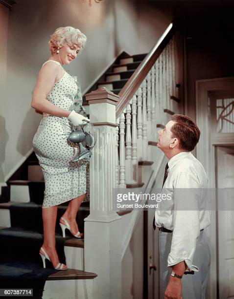 American actors Marilyn Monroe and Tom Ewell on the set of The Seven Year Itch directed by Billy Wilder