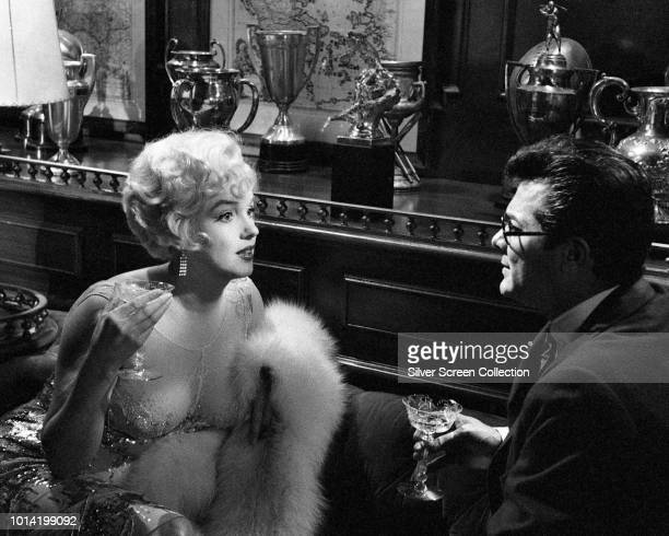 American actors Marilyn Monroe and Tony Curtis attempt to seduce each other in a scene from the comedy 'Some Like It Hot' 1959