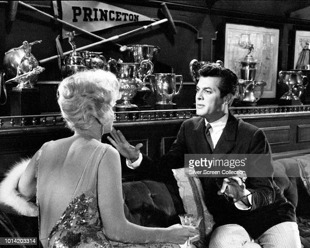 American actors Marilyn Monroe and Tony Curtis attempt to seduce each other in a scene from the comedy 'Some Like It Hot', 1959.