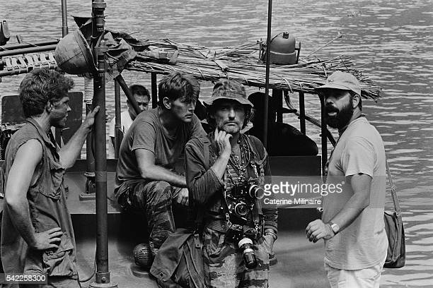 American actors Martin Sheen and Dennis Hopper with director Francis Ford Coppola on the set of the his movie Apocalypse Now based on Joseph Conrad's...