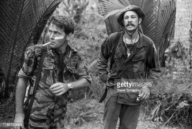 American actors Martin Sheen and Frederic Forrest walk together on the set of their film, 'Apocalypse Now' , Philippines, 1978.