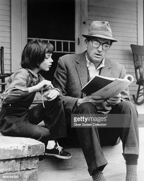 American actors Mary Badham and Gregory Peck on the set of 'To Kill a Mockingbird' , 1962.