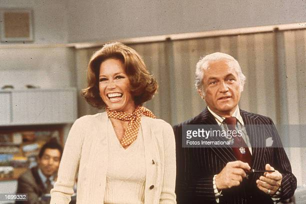 American actors Mary Tyler Moore and Ted Knight laugh in a still from the television series 'The Mary Tyler Moore Show' circa 1976