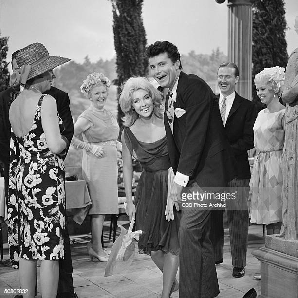 American actors Max Baer Jr and Sharon Tate laugh with during a party scene from 'The Garden Party' episode of 'The Beverly Hillbillies' August 1 1963