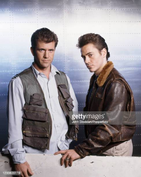 """American actors Mel Gibson and Robert Downey Jr, co-stars in the film """"Air America"""" , photographed circa 1990."""