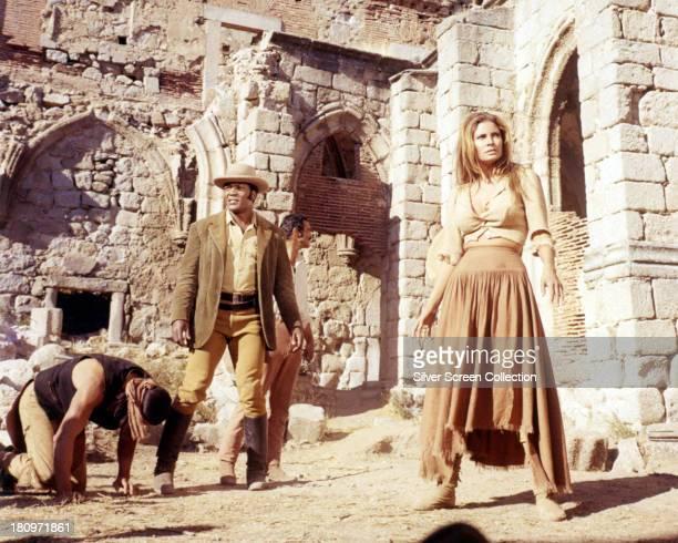 American actors Michael Forest as Humara Jim Brown as Lyedecker Burt Reynolds as Yaqui Joe Herrera and Raquel Welch as Sarita in the western '100...
